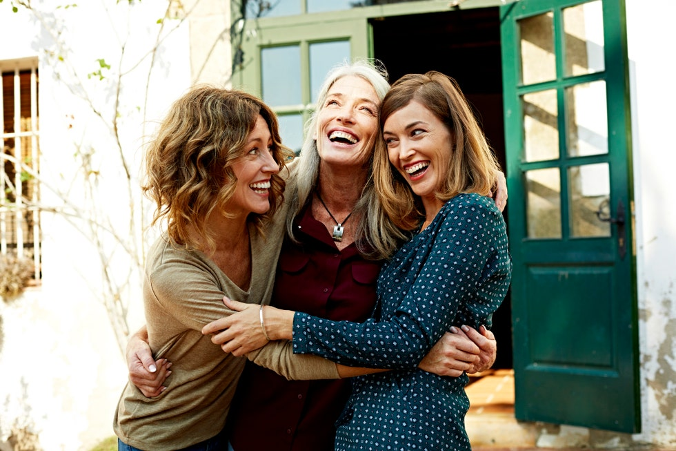 mother and daughters embracing outdoors royalty free image 1594637372
